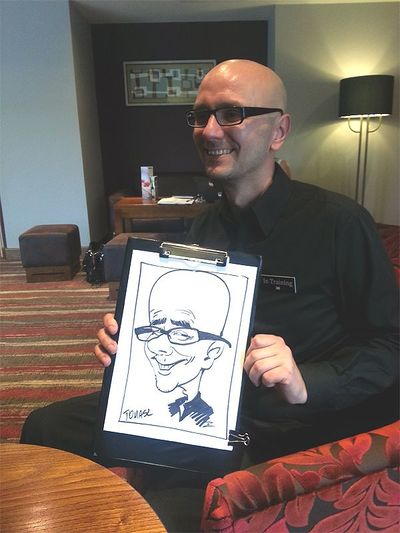 Caricature of man with glasses