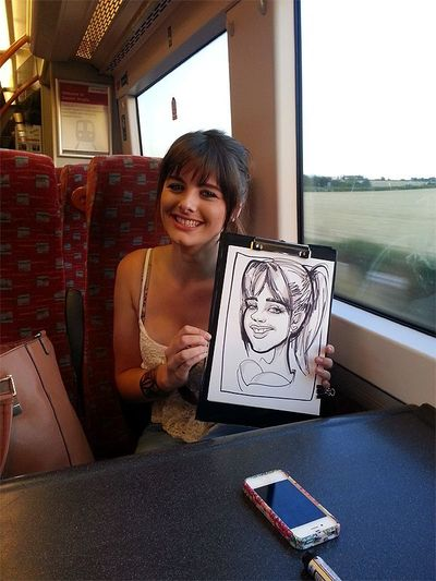 Caricatures on a train